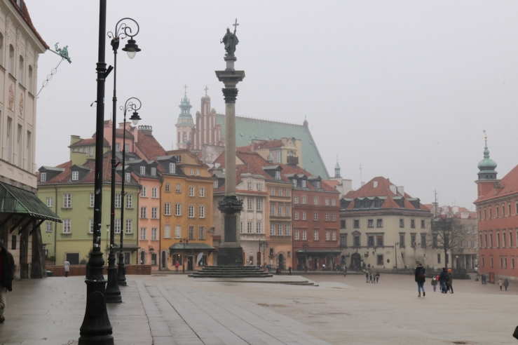Royal Castle square with column and view towards Old Town