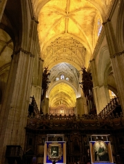 Nave of the Seville cathedral with the altar in the back
